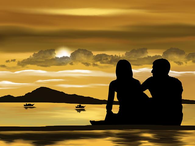 Zamilovaný pár při západu slunce